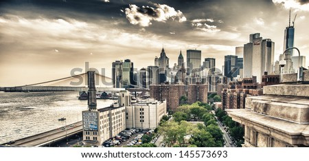 Beautiful sunset view of Lower Manhattan from Manhattan Bridge. - stock photo