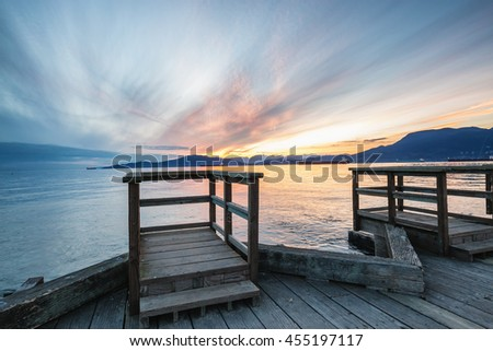 Beautiful sunset viewed from a dock in Jericho Beach, Vancouver, British Columbia, Canada. - stock photo