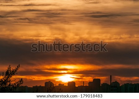 Beautiful sunset with bright Sun over skyline. Moscow, Russia.  - stock photo