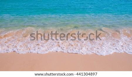 Beautiful surf wave on tropical sandy beach - stock photo