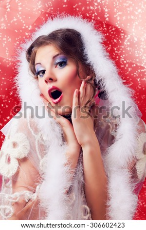beautiful surprised woman against red background, Christmas topic - stock photo