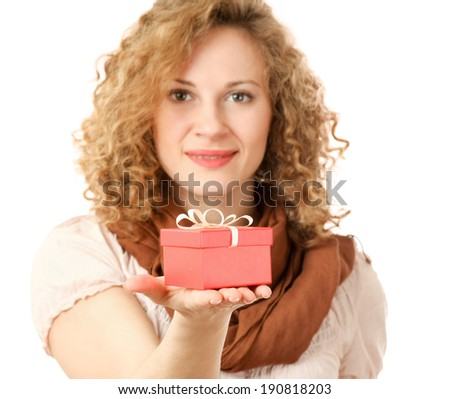 Beautiful surprised woman holding gift with ribbon - stock photo