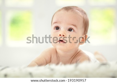 Beautiful sweet baby looking up - stock photo