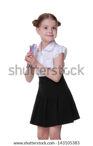Beautiful sweet little girl holding felt tip pens on Education concept theme/Cheerful schoolgirl wearing white blouse and black skirt and holding lots of colorful felt tip pens - stock photo