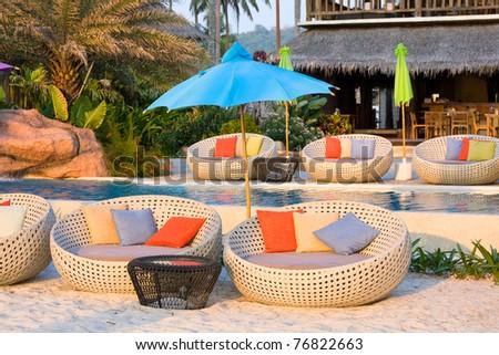 Beautiful swimming pool at sunset , Thailand - stock photo