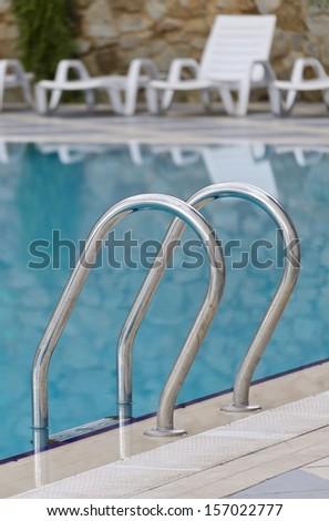 Beautiful swimming pool in hotel - stock photo