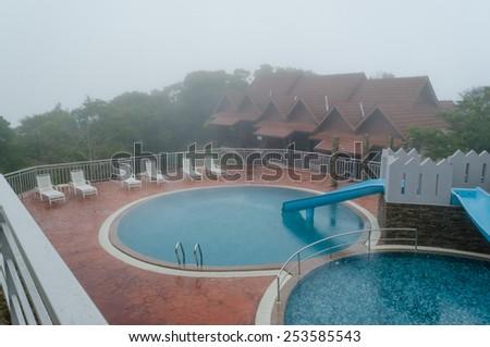 Beautiful Swimming Pool over mountain - stock photo