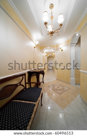 Beautiful table in a light corridor with a door - stock photo