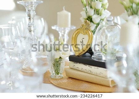 Beautiful table set for an event party or wedding reception - stock photo