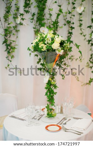 Beautiful table set with flowers - stock photo
