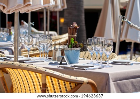 Beautiful table setting in an outdoor restaurant - stock photo