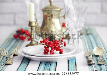 Beautiful table setting with vintage silverware - stock photo