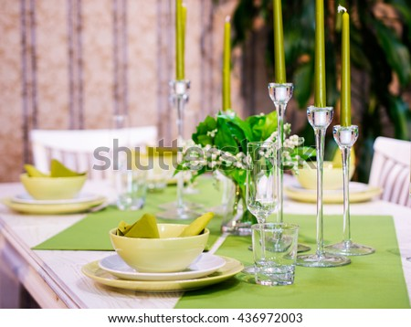 Beautiful table setting with white and green colors. Shallow DOF - stock photo