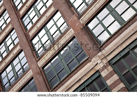 Beautiful tall office building exterior with reflections - stock photo