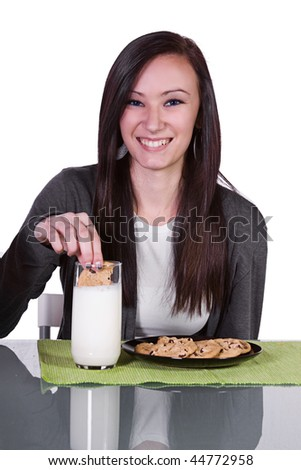 Beautiful Teen Girl  Eating Cookies with a Glass of Milk - Isolated - stock photo