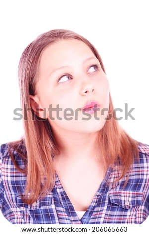 Beautiful teen girl looking up and thinking about something - stock photo