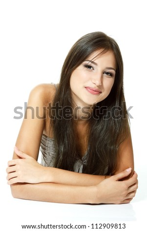 Beautiful teen girl lying down and smiling. Isolated on white background - stock photo