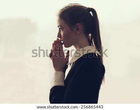 beautiful teen girl praying - stock photo