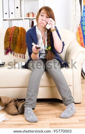 Beautiful teen girl sad at home alone - stock photo