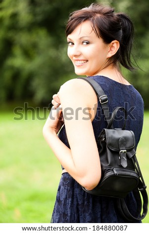 beautiful teen girl, smiling in the park - stock photo