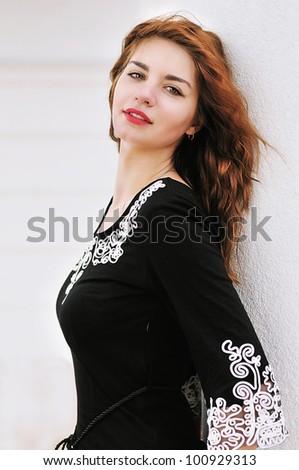 beautiful teen girl standing near the wall - stock photo