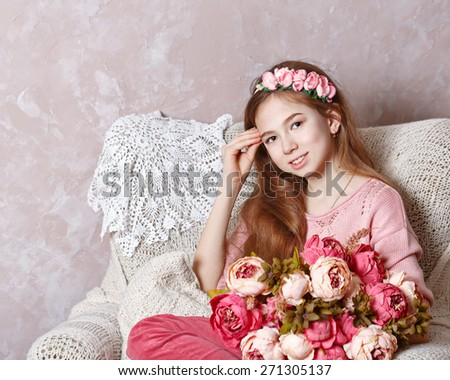 Beautiful teen girl with a bouquet of spring flowers in home interior. - stock photo