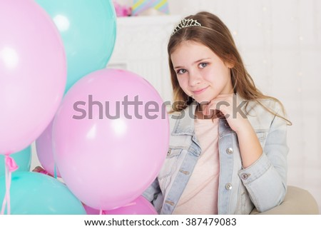 Beautiful teen girl with blue and pink balloons - stock photo