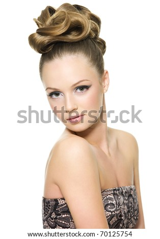 Beautiful teen girl with curly hairstyle and bright makeup - on white background - stock photo