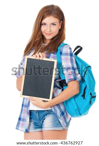 Beautiful teen girl with small blackboard and school bag, posing on white background - stock photo