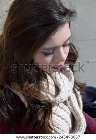 Beautiful teenage Caucasian and Asian girl looking down - stock photo
