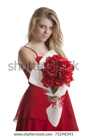Beautiful teenage girl in a red dress holding a bouquet of roses isolated on white background - stock photo