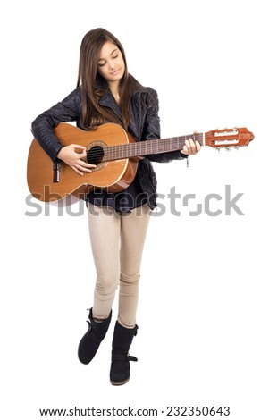 Beautiful teenage girl playing guitar  isolated on white background - stock photo