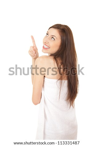 beautiful teenage girl pointing and looking up, white background - stock photo