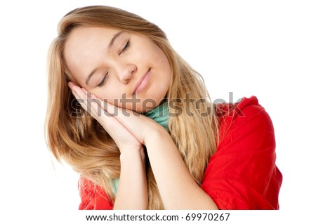 beautiful teenage girl sleeping with her hands under her head. Eyes closed and smiling, isolated on white background - stock photo