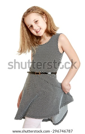 Beautiful teenage girl with long blonde hair in a light silk dress, girl holding his hand the hem of the dress-Isolated on white - stock photo