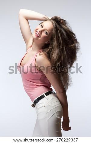 Beautiful Teenage Girl with Long Brown Hair Smiling - stock photo