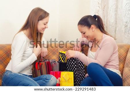 Beautiful teenage girlfriends having fun after shopping. - stock photo