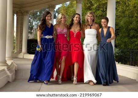 Beautiful Teenage Girls Walking in their Prom Dresses  - stock photo
