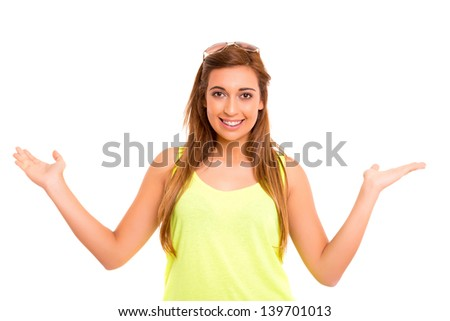 Beautiful teenager making a scale with her arms wide open, isolated in a white background - stock photo
