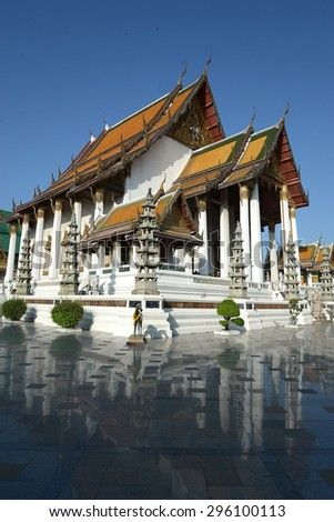 Beautiful temple architecture of Wat Suthat Thepphawararam with blue sky background in Bangkok, Thailand  - stock photo