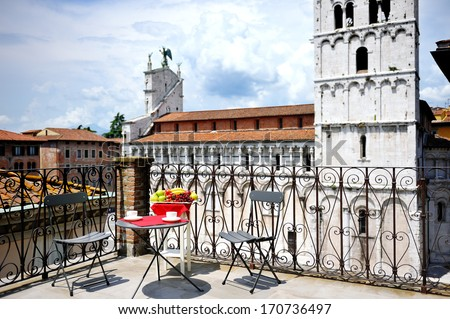 beautiful terrace overlooking the cathedral of Lucca, Tuscany, Italy - stock photo