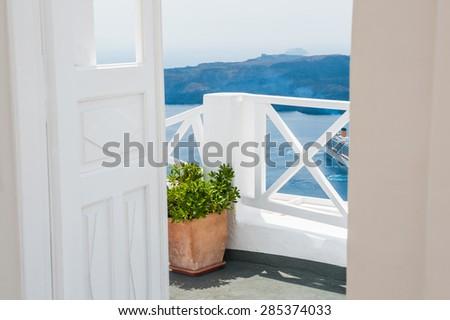 Beautiful terrace with sea view. White architecture on Santorini island, Greece.  - stock photo