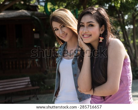 Beautiful Thai Asian Model Friends, Pose in Outdoor Natural Setting - stock photo