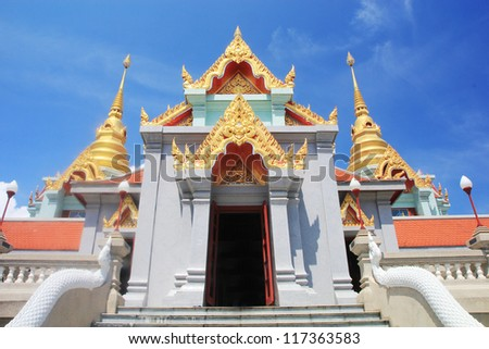 Beautiful thai buddha temple with blue sky background - stock photo