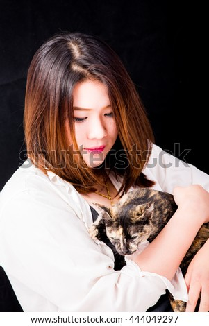 beautiful Thai girl with black  background - stock photo