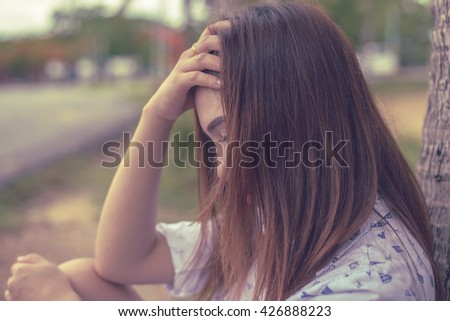 Beautiful thai woman very sad from unrequited love,rethink,think over - stock photo