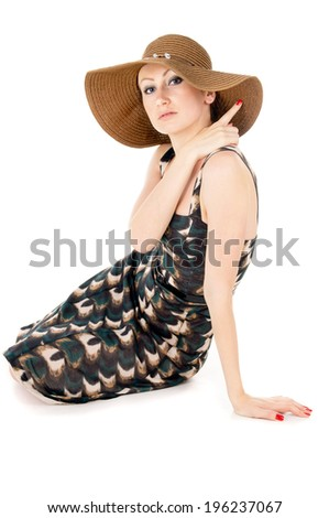 beautiful the girl wore a big hat isolated on white background - stock photo