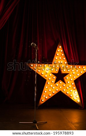 beautiful theater stage with red curtains and microphon - stock photo
