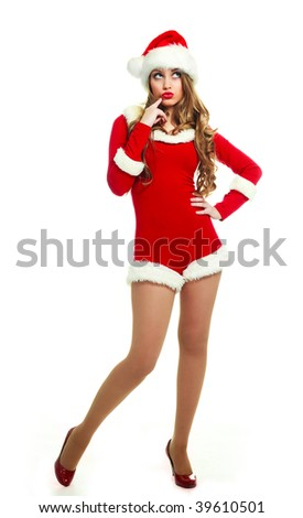 beautiful thoughtful sexy girl dressed as Santa against white background - stock photo