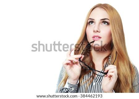 Beautiful thoughtful woman holding glasses. - stock photo